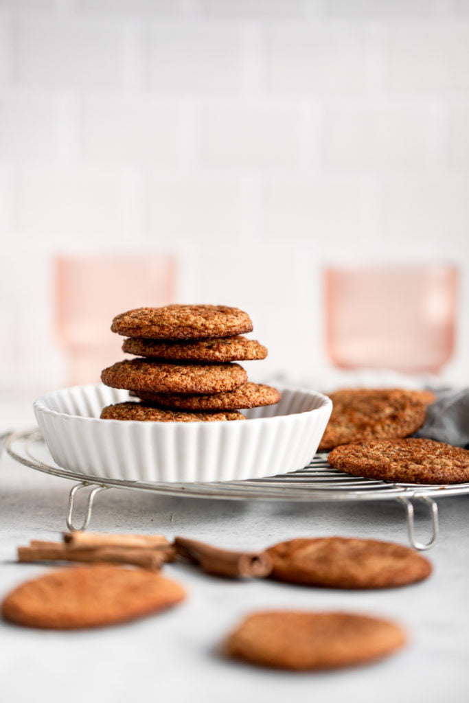 snickerdoodle cookies in a white dish on a wire rack
